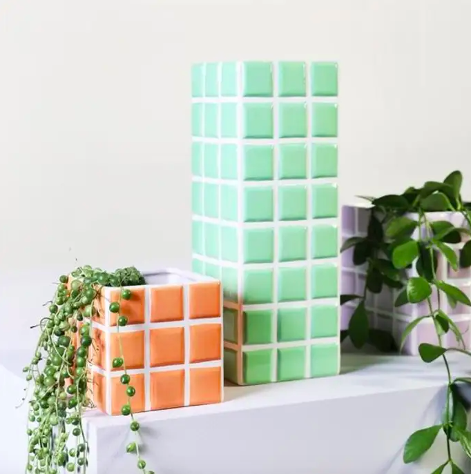 """The Dutch brand &Klevering always has its finger on the pulse when it comes to trends so it's no surprise to find it has its own range of tiled planters and vases.<br><br><strong>&klevering</strong> Pink Tile Vase, $, available at <a href=""""https://www.trouva.com/products/andklevering-tile-vase-mint"""" rel=""""nofollow noopener"""" target=""""_blank"""" data-ylk=""""slk:Trouva"""" class=""""link rapid-noclick-resp"""">Trouva</a>"""