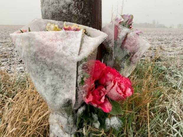 Flowers are placed in Sturgeon County in memory of a 16-year-old girl who was killed in a single-vehicle crash on Monday.  (Nathan Gross/CBC - image credit)