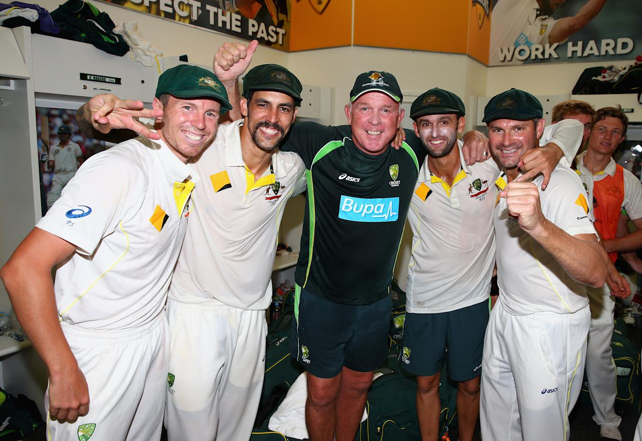 PERTH, AUSTRALIA - DECEMBER 17: Peter Siddle,  Mitchell Johnson, Craig McDermott, Nathan Lyon and Ryan Harris of Australia celebrate victory in the change rooms during day five of the Third Ashes Test Match between Australia and England at WACA on December 17, 2013 in Perth, Australia.  (Photo by Ryan Pierse/Getty Images)