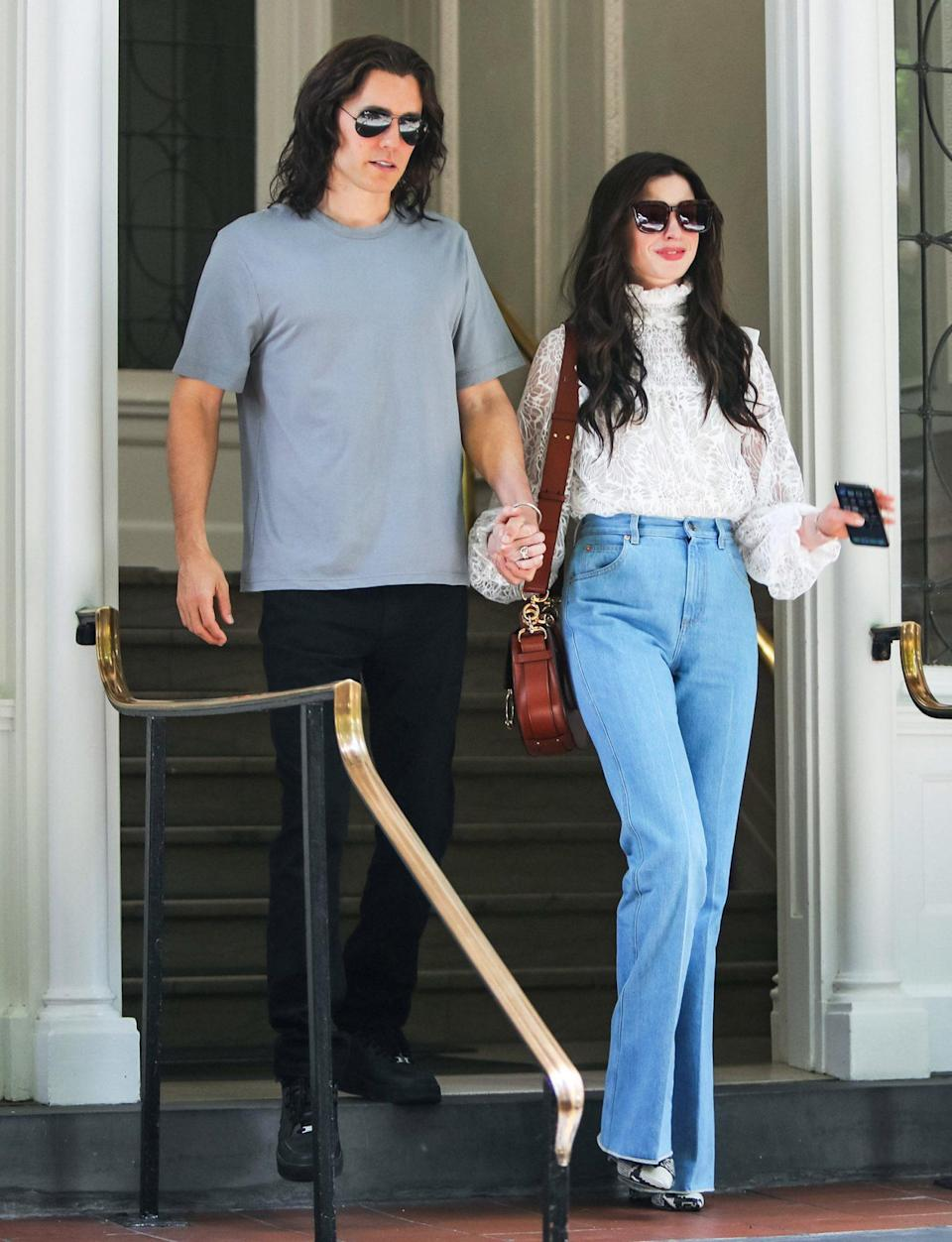 <p>Jared Leto and Anne Hathaway hold hands while filming a scene for <i>WeCrashed </i>on June 8 in N.Y.C. </p>