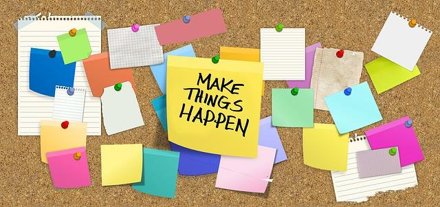 """post-its with the focus on one saying """"Make Things Happen"""""""