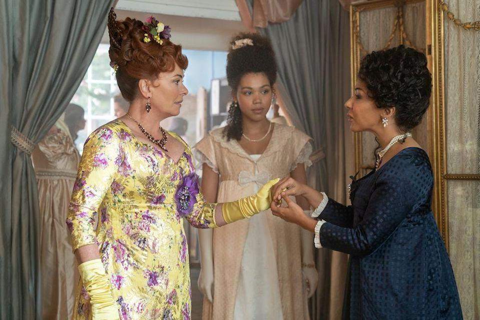 """<p>Kathryn Drysdale plays the dressmaker Genevieve Delacroix in <em>Bridgerton</em>, but viewers of the royals-centric comedy <em><a href=""""https://www.netflix.com/watch/80216651?source=35"""" rel=""""nofollow noopener"""" target=""""_blank"""" data-ylk=""""slk:The Windsors"""" class=""""link rapid-noclick-resp"""">The Windsors </a></em>will know her as Meghan Markle.She was also in the 2004 <em><a href=""""https://www.amazon.com/gp/video/detail/amzn1.dv.gti.96a9f736-8ad4-2ab1-e03f-ba0c367c10a5?autoplay=1&ref_=atv_cf_strg_wb&tag=syn-yahoo-20&ascsubtag=%5Bartid%7C10072.g.34930956%5Bsrc%7Cyahoo-us"""" rel=""""nofollow noopener"""" target=""""_blank"""" data-ylk=""""slk:Vanity Fair"""" class=""""link rapid-noclick-resp"""">Vanity Fair </a></em>movie (Claudia Jessie, a.k.a Eloise, was in the 2018 <a href=""""https://www.amazon.com/gp/video/detail/amzn1.dv.gti.2eb3d1c0-88e4-9466-e3a0-c5da6a458053?autoplay=1&ref_=atv_cf_strg_wb&tag=syn-yahoo-20&ascsubtag=%5Bartid%7C10072.g.34930956%5Bsrc%7Cyahoo-us"""" rel=""""nofollow noopener"""" target=""""_blank"""" data-ylk=""""slk:miniseries remake"""" class=""""link rapid-noclick-resp"""">miniseries remake</a>).</p><p><strong>Follow Her on Instagram: </strong>@<a href=""""https://www.instagram.com/katkindrysdale/?hl=en"""" rel=""""nofollow noopener"""" target=""""_blank"""" data-ylk=""""slk:katkindrysdale"""" class=""""link rapid-noclick-resp"""">katkindrysdale</a></p>"""