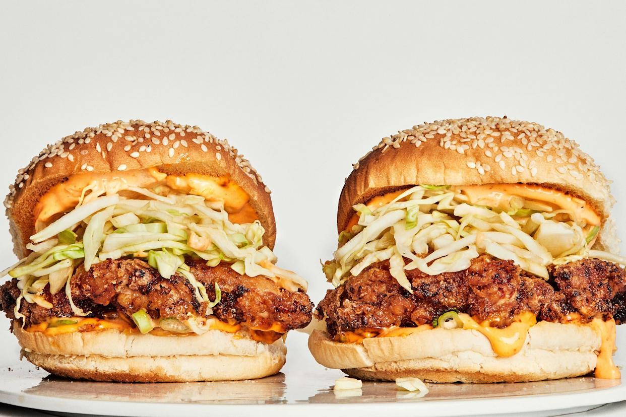 """This recipe is super simple and the easiest of the bunch to make at home. The use of chicken thighs instead of breasts promises a tender patty, and disregarding everything we said above, it uses neither a brine nor seasoned flour. It also features a killer slaw and Sriracha mayo.&nbsp;<strong>Get <a href=""""https://www.bonappetit.com/recipe/basically-fried-chicken-sandwich"""" rel=""""nofollow noopener"""" target=""""_blank"""" data-ylk=""""slk:The Basically Fried Chicken Sandwich"""" class=""""link rapid-noclick-resp"""">The Basically Fried Chicken Sandwich</a> recipe from Bon App&eacute;tit</strong>"""