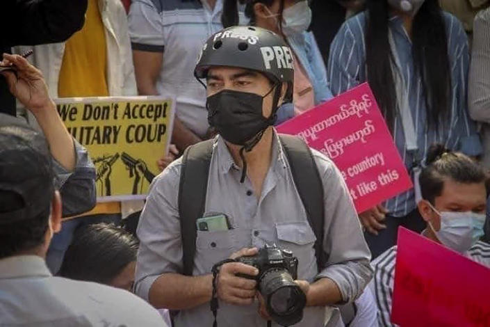 In this undated photo provided by the Democratic Voice of Burma (DVB), journalist Min Nyo covers an anti-coup protest in Pyay, Myanmar. Min Nyo, a correspondent for the online and broadcast news agency DVB, was sentenced on May 12, 2021 by a Myanmar military court to three years in prison for his reporting. (Democratic Voice of Burma via AP)