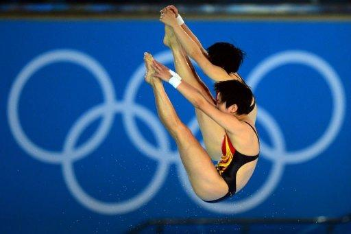China's Chen Ruolin and Wang Hao compete in the women's synchronised 10m platform final