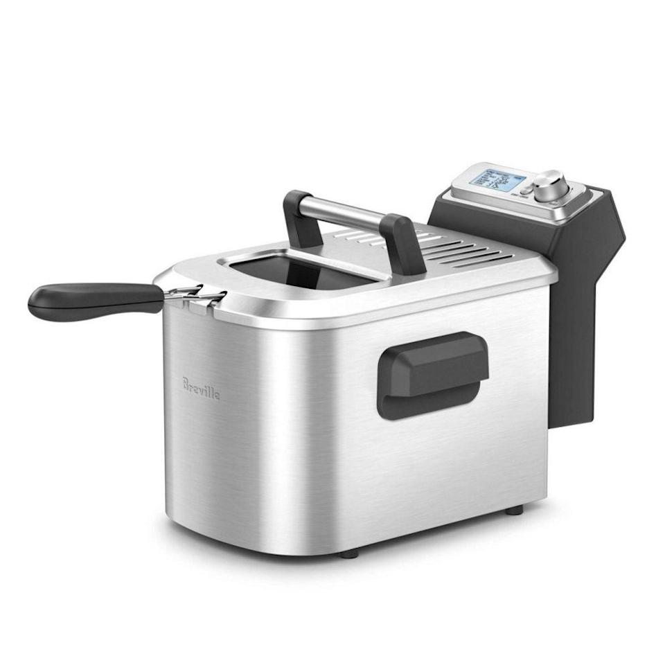 """<p><strong>Breville</strong></p><p>breville.com</p><p><strong>$149.95</strong></p><p><a href=""""https://go.redirectingat.com?id=74968X1596630&url=https%3A%2F%2Fwww.breville.com%2Fus%2Fen%2Fproducts%2Fwoks-skillets-deep-fryers%2Fbdf500.html&sref=https%3A%2F%2Fwww.delish.com%2Fkitchen-tools%2Fcookware-reviews%2Fg33667534%2Fbest-deep-fryers%2F"""" rel=""""nofollow noopener"""" target=""""_blank"""" data-ylk=""""slk:BUY NOW"""" class=""""link rapid-noclick-resp"""">BUY NOW</a></p><p>The smart fryer's digital system comes with six preprogramed frying settings (for fries, twice fried fries, fish, wings, calamari, and donuts) plus customizable shortcuts for the temperature and timing you find works best. </p>"""