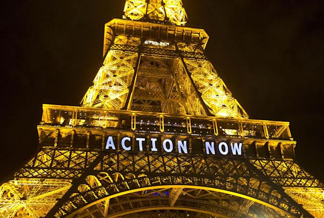 "<p>The Eiffel Tower lights up with the slogan ""Action Now"" referring to the COP21, United Nations Climate Change Conference in Paris, Dec. 6, 2015. The carbon footprint for the COP21 conference runs to thousands of tons, for the some 40,000 people, including heads of state, negotiators, activists and journalists, in Paris to hash out a ground-breaking international agreement to put a brake on global warming. (AP Photo/Michel Euler) </p>"
