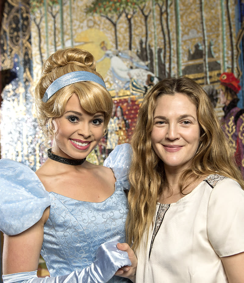 <p>Actress Drew Barrymore once played the fairy-tale princess in the movie <i>Ever After</i>, but she came face to face with Disney's version of the character during a family vacation at Walt Disney World. (Photo: David Roark/Disney) </p>