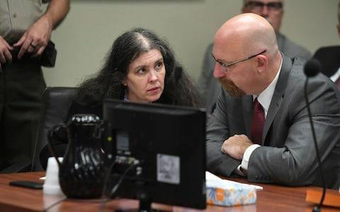 <span>Louise Turpin, left, listens to her attorney, Jeff Moore, during a sentencing hearing Friday</span> <span>Credit: AP </span>