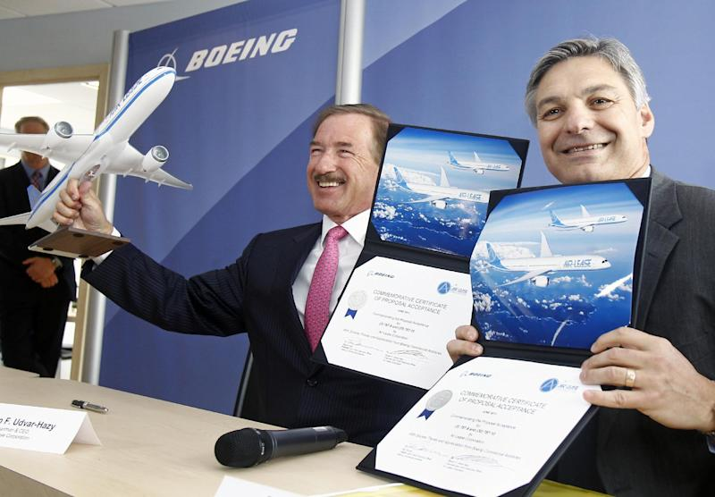 Air Lease Corporation chairman and chief executive officer Steven F. Udvar-Mazy, left, and Boeing Commercial Airplane President and chief executive officer Ray Conner, right, pose while holding documents, after signing a memorandum of understanding to purchase 33 airplanes. The Los Angeles-based leasing company has committed to order three 787-9 and 30 787-10X Dreamliners, during the 50th Paris Air Show, in Le Bourget, France, Tuesday, June 18, 2013. (AP Photo/Remy de la Mauviniere)