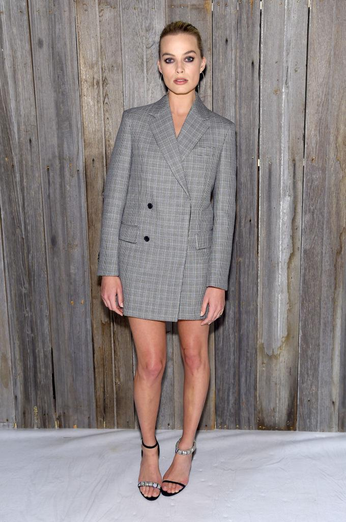 <p>Margot Robbie joined the FROW at Calvin Klein dressed in an oversized blazer dress accessorised the nineties-inspired heels. <em>[Photo: Getty]</em> </p>