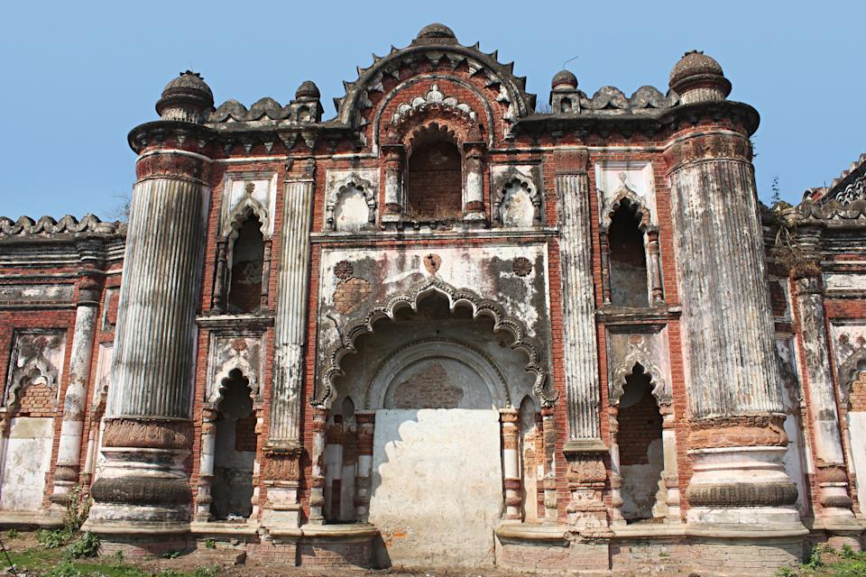 Tall pilasters, fluted pillars and scalloped arches in distintly european style blended with Indian elements,wall of old palace Darbhanga, Bihar, India