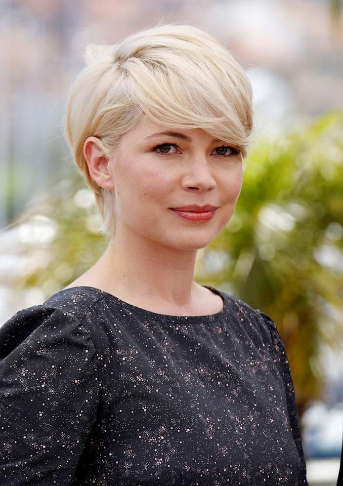 "But the ultra-cropped, bleached coif she debuted at the Cannes Film Festival in May while promoting her upcoming flick ""Blue Valentine"" just screamed indie ""it"" girl. Mike Marsland/<a href=""http://www.wireimage.com"" target=""new"">WireImage.com</a> - May 18, 2010"