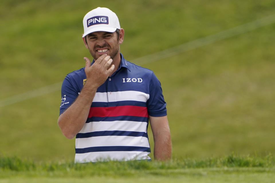 Louis Oosthuizen, of South Africa, reacts after his shot from a bunker on the 11th hole during the second round of the U.S. Open Golf Championship, Friday, June 18, 2021, at Torrey Pines Golf Course in San Diego. (AP Photo/Jae C. Hong)