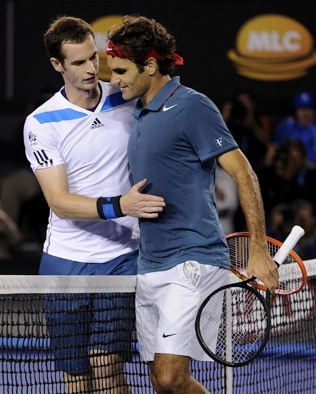 Roger Federer of Switzerland, right, is congratulated by Andy Murray of Britain at the net after Federer won their quarterfinal at the Australian Open tennis championship in Melbourne, Australia, Wednesday, Jan. 22, 2014.(AP Photo/Andrew Brownbill)