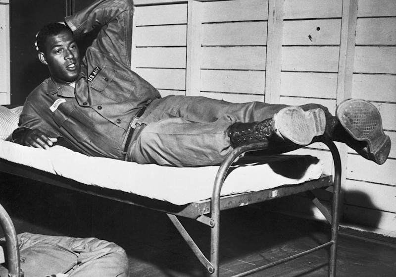 Lakers star Elgin Baylor served his country in the U.S. Army Reserves three seasons after his protest. (Getty Images)