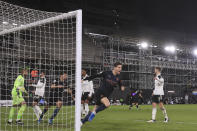 Manchester City's John Stones, 2nd right, celebrates after scoring his side's opening goal during an English Premier League soccer match between Fulham and Manchester City at the Craven Cottage stadium in London, England, Saturday March 13, 2021. (Adam Davy/Pool via AP)