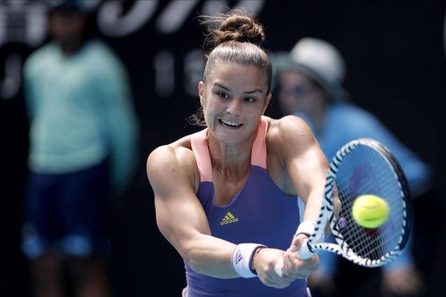 Greece's Maria Sakkari returns a shot against Madison Keys of the U.S. in their third round singles match at the Australian Open tennis championship in Melbourne, Australia, Friday, Jan. 24, 2020. (AP Photo/Andy Wong)
