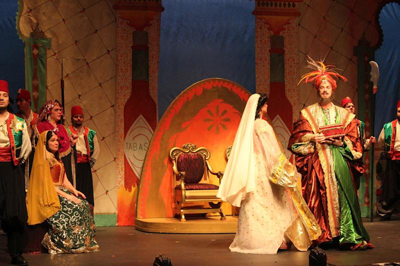 "In this Jan. 22, 2018 photo, Betsy Uschkrat as Fatima and Kennety Weber as the Bey (Sultan) of Tangier, perform during the New Orleans Opera's dress rehearsal for the 1894 light opera ""Tabasco: A Burlesque Opera"" at Le Petit Theatre in New Orleans. The show is scheduled Jan. 25-28 as part of New Orleans' 300th anniversary, the 150th anniversary for Tabasco and the 75th for the New Orleans Opera. (AP Photo/Janet McConnaughey)"