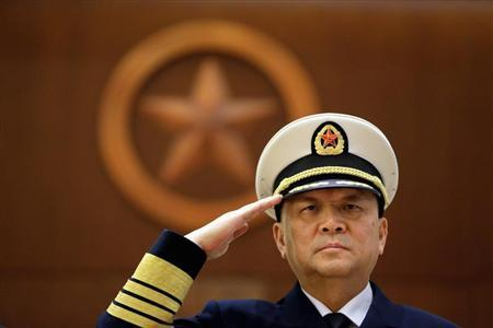 Commander of PLA Navy Wu salutes during a welcoming ceremony in Beijing