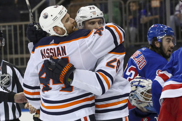 Edmonton Oilers center Leon Draisaitl (29) celebrates after scoring a goal against the New York Rangers with right wing Zack Kassian (44) during the third period of an NHL hockey game, Saturday, Oct. 12, 2019, at Madison Square Garden in New York. The Oilers won 4-1. (AP Photo/Mary Altaffer)
