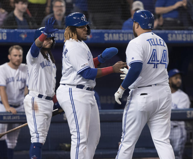 Toronto Blue Jays' Rowdy Tellez is met by teammates Vladimir Guerrero Jr. and Freddy Galvis after he hit a two-run home run against the Boston Red Sox during the fourth inning of a baseball game Tuesday, May 21, 2019, in Toronto. (Fred Thornhill/The Canadian Press via AP)