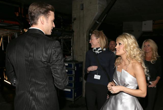 Singers Carrie Underwood and Justin Timberlake backstage during the 55th Annual Grammy Awards at the Staples Center on Feb. 10, 2013, in Los Angeles. (Photo: Christopher Polk/Getty Images for NARAS)