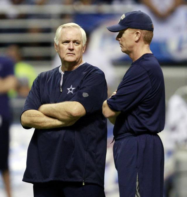 "FILE - In this Aug. 2, 2010, file photo, then-Dallas Cowboys head coach Wade Phillips, left, and then-offensive coordinator Jason Garrett chat during the team's NFL football training camp, in San Antonio. Phillips, the 71-year-old Los Angeles defensive coordinator who was fired as Dallas head coach in 2010 and replaced by his assistant, Jason Garrett, calls this weekend's divisional playoff showdown "" a revenge game for me."" (AP Photo/Eric Gay, File)"