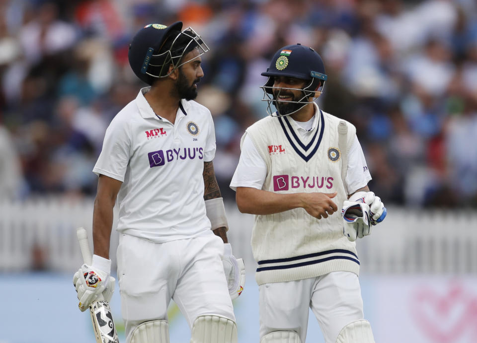 <p>Cricket - Second Test - England v India - Lord's Cricket Ground, London, Britain - August 12, 2021 India's KL Rahul and Virat Kohli walk off for tea Action Images via Reuters/Paul Childs</p>