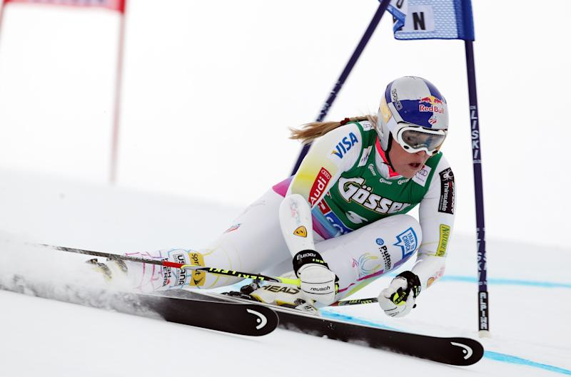 "FILE - In this Saturday, Oct. 27, 2012 file photo, Lindsey Vonn, of the U.S., clears a gate during the first run of an alpine ski, women's World Cup giant slalom, in Soelden, Austria. Vonn's request to compete in a men's World Cup downhill race has been rejected by the International Ski Federation. The FIS council met Saturday, Nov. 3, 2012, in Oberhofen, Switzerland, and ""confirmed that one gender is not entitled to participate in races of the other,"" adding in a statement that ""exceptions will not be made to the FIS Rules."" (AP Photo/Alessandro Trovati, File)"