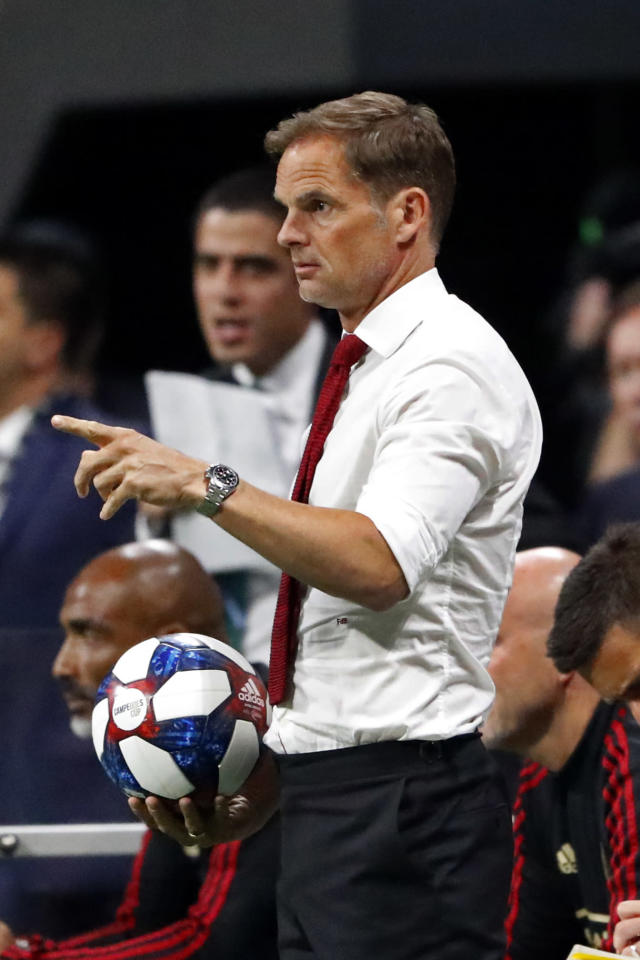"Atlanta United coach Frank de Boer looks on from the side line during the first half of the team's Campeones Cup soccer final gainst Club America on Wednesday, Aug. 14, 2019, in Atlanta. De Boer said he regrets his choice of words in a British newspaper interview about gender equity in soccer and stressed that he's a big supporter of the women's game. De Boer faced backlash before Wednesday's Campeones Cup game for his comments in an article published by The Guardian, in which he said it was ""ridiculous"" that female players expect to receive the same World Cup pay as the men. (AP Photo/John Bazemore)"