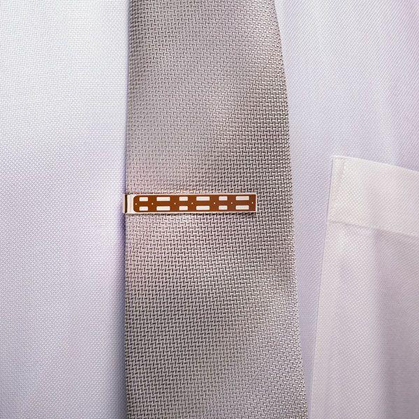 """<h3>The Star Wars Fan Dad</h3><p>Your dad will appreciate this tie bar modeled after his favorite Wookiee's bandolier. Only true members of the Rebel Alliance will be hip to your dad's subtle ode to Chewbacca.</p><br><br><strong>Think Geek</strong> Chewbacca Tie Bar, $35.97, available at <a href=""""https://www.thinkgeek.com/product/khls/"""" rel=""""nofollow noopener"""" target=""""_blank"""" data-ylk=""""slk:Think Geek"""" class=""""link rapid-noclick-resp"""">Think Geek</a>"""