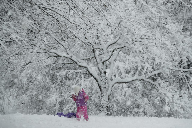 <p>A young girl plays in the snow during a winter storm on March 7, 2018, in Marple Township, Pa. (Photo: Matt Slocum/AP) </p>