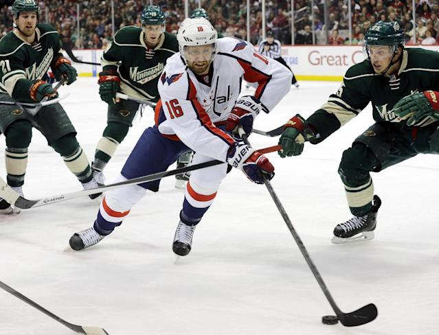 Washington Capitals right wing Eric Fehr (16) controls the puck past Minnesota Wild defenseman Jonas Brodin, right, during the second period of an NHL hockey game in St. Paul, Minn., Saturday, Jan. 4, 2014. (AP Photo/Ann Heisenfelt)