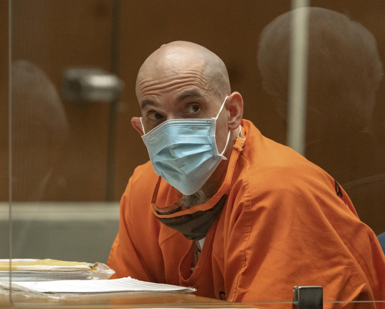 """Michael Thomas Gargiulo listens to his defense attorney Daniel Nardoni, as he pleads for his life during a sentencing hearing at Los Angeles Superior Court, Friday, July 16, 2021. A judge denied a new trial for Garigiulo, a man prosecutors called """"The Boy Next Door Killer,"""" who could be sentenced to death later Friday for the home-invasion murders of two women and the attempted murder of a third.   (AP Photo/Damian Dovarganes)"""