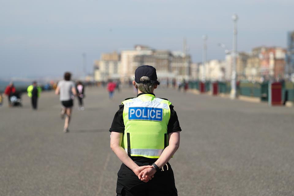 A police officer patrols Brighton sea front, as the UK continues in lockdown to help curb the spread of the coronavirus.