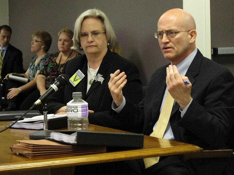 Federal public defender Joe Wilhelm, right, argues a point to the Ohio Parole Board on behalf of his client, death row inmate Billy Slagle, whille public defender Vicki Werneke listens, on Monday, July 8, 2013, at the parole board in Columbus, Ohio. Wilhelm and Werneke have asked the board to commute Slagle's death sentence to life without parole. (AP Photo/Andrew Welsh-Huggins)