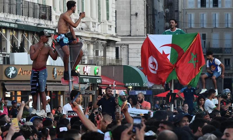 Algerian supporters celebrate in Marseille after their team's victory.