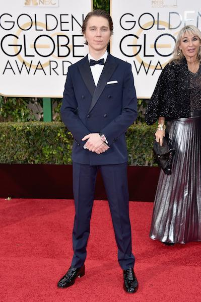 Paul Dano in a navy blue double-breasted tux at the 73rd Golden Globe Awards.