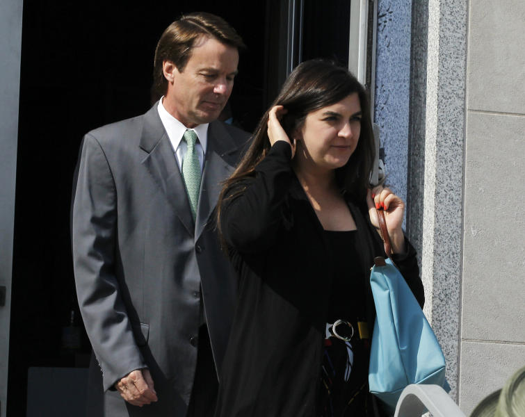 Former Sen. John Edwards and his daughter Cate Edwards leave the Federal Courthouse in Greensboro, N.C. Thursday May 3, 2012 after court finished for the day. Edwards is accused of conspiring to secretly obtain more than $900,000 from two wealthy supporters to hide his extramarital affair with Rielle Hunter and her pregnancy from the media. He has pleaded not guilty to six charges related to violations of campaign-finance laws. (AP Photo/The News & Observer, Chuck Liddy) MANDATORY CREDIT