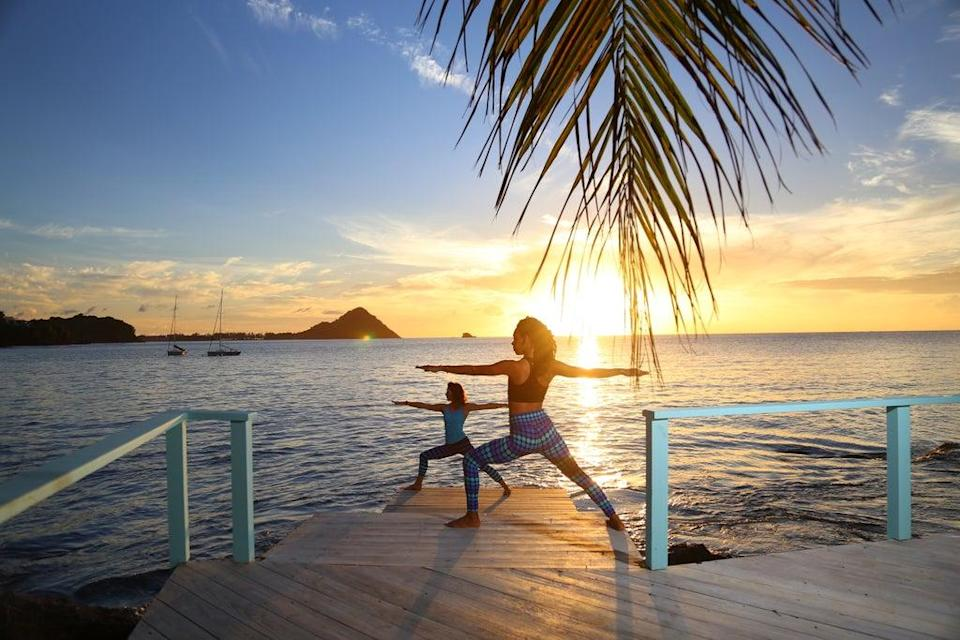Yoga on the boardwalk at BodyHoliday resort, St. Lucia (BodyHoliday/PA)