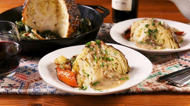 """<p>This roasted cabbage is the way to go if you're looking for some vegetarian-friendly! It's savoury, sweet, and salty on the outside and super tender on the inside. </p><p>Get the <a href=""""https://www.delish.com/uk/cooking/recipes/a29695876/thanksgiving-cabbage-recipe/"""" rel=""""nofollow noopener"""" target=""""_blank"""" data-ylk=""""slk:Whole Roasted Cabbage"""" class=""""link rapid-noclick-resp"""">Whole Roasted Cabbage</a> recipe.</p>"""