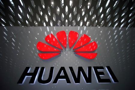 FILE PHOTO: A Huawei company logo is pictured at the Shenzhen International Airport in Shenzhen
