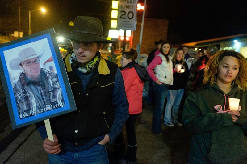 "A group of more than 20 people marched up and down N. Broadway Avenue in Burns, Oregon, January 27, 2016, holding a candlelight celebration of the life for Robert ""LaVoy"" Finicum, who would have turned 56 years old on this day (AFP Photo/Rob Kerr)"