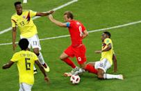 <p>Harry Kane is brought down by Jefferson Lerma </p>