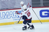 Washington Capitals left wing Jakub Vrana (13) celebrates after scoring a goal with center Nicklas Backstrom (19) during the third period of an NHL hockey game against the New Jersey Devils, Saturday, Feb. 27, 2021, in Newark, N.J. (AP Photo/Mary Altaffer)