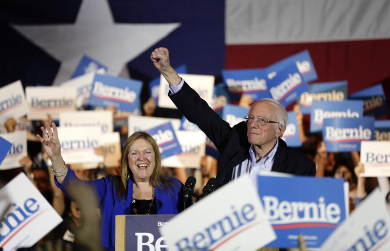 Sen. Bernie Sanders, I-Vt., right, with his wife Jane, raises his hand as he speaks during a campaign event in San Antonio on Feb. 22, 2020. (Eric Gay/AP)