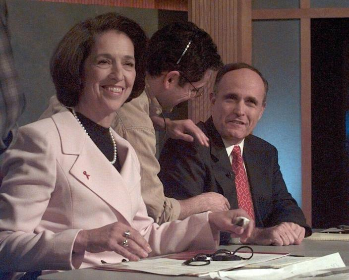 New York Democratic mayoral candidate Ruth Messinger, left, and her Republican opponent, incumbent Rudy Giuliani, right, prepare for a televised debate at WABC studios in New York Wednesday, Oct. 29, 1997.