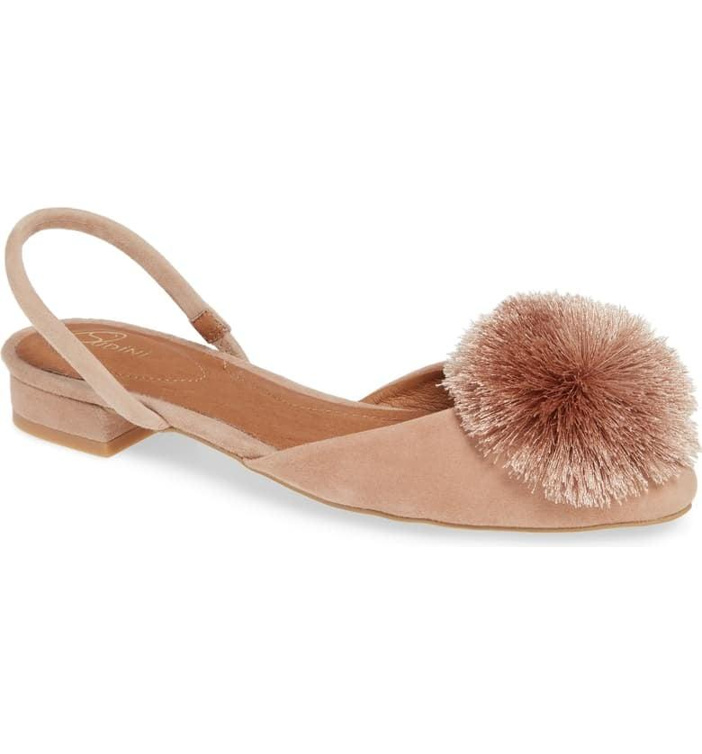 "<p>Play up your look with these <a href=""https://www.popsugar.com/buy/Sudini-Arta-Pom-Slingback-Flats-477104?p_name=Sudini%20Arta%20Pom%20Slingback%20Flats&retailer=shop.nordstrom.com&pid=477104&price=50&evar1=fab%3Aus&evar9=46471709&evar98=https%3A%2F%2Fwww.popsugar.com%2Ffashion%2Fphoto-gallery%2F46471709%2Fimage%2F46472803%2FSudini-Arta-Pom-Slingback-Flats&list1=shopping%2Cshoes%2Cflats%2C50%20under%20%2450%2Caffordable%20shopping&prop13=mobile&pdata=1"" rel=""nofollow"" data-shoppable-link=""1"" target=""_blank"" class=""ga-track"" data-ga-category=""Related"" data-ga-label=""https://shop.nordstrom.com/s/sudini-arta-pom-slingback-flat-women/5195948?origin=category-personalizedsort&amp;breadcrumb=Home%2FWomen%2FShoes%2FFlats&amp;color=nude%20suede"" data-ga-action=""In-Line Links"">Sudini Arta Pom Slingback Flats</a> ($50, originally $90).</p>"