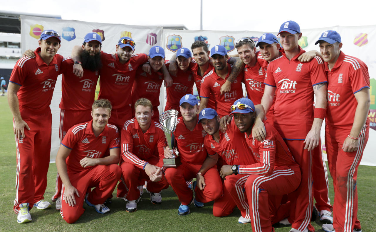 England's team poses with the trophy after defeating West Indies 2-1 in their series of three one-day international cricket matches at the Sir Vivian Richards Cricket Ground in St. John's, Antigua, Wednesday, March 5, 2014. (AP Photo/Ricardo Mazalan)